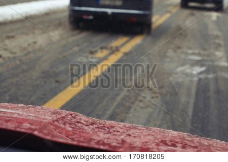 Reckless driving on icy road - horizontal