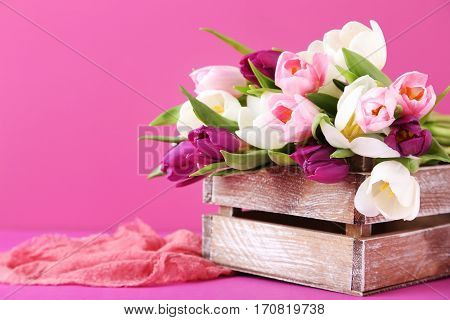 Bouquet Of Tulips In Crate On Pink Background