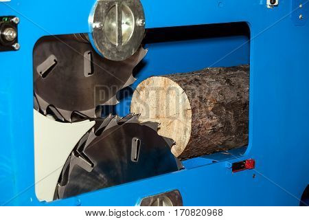 Woodworking machine in action. Timber cutting machine. Wood processing equipment