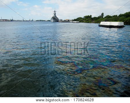 Oil still floats on the top of the water where it was spilled when the USS Arizona was sunk during the attack on Pearl Harbor Oahu Hawaii. poster