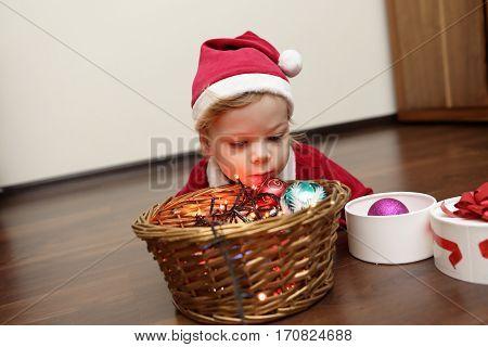 Christmas Child Lying On Floor