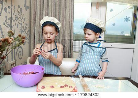 Two Serious Children Mold Dumplings