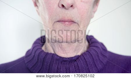 closeup of older womans mouth and wrinkled chin
