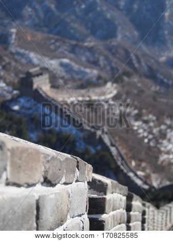 A shallow depth of field emphasises the details of the Great Wall of China.