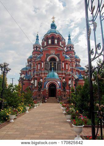Historic red Kazan Russian Orthodox Church in Irkutsk Russia.