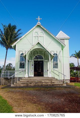 A quaint green historic painted church the Star of the Sea near Hilo on Hawaii's Big Island.