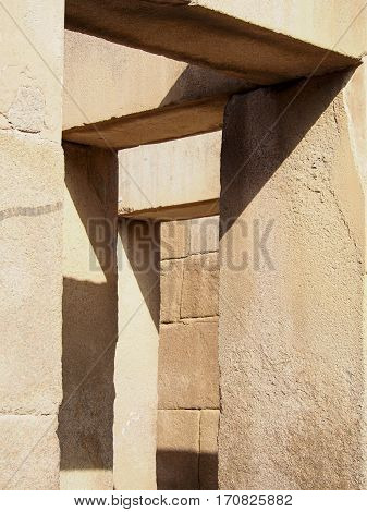Geometric shadows fall on windows in the ancient Egyptian ruins of Giza.
