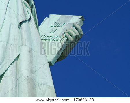 A detail of the Statue of Liberty in the harbor of New York City.