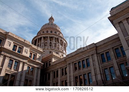 The exterior of the Texas State Capitol building in downtown Austin Texas.