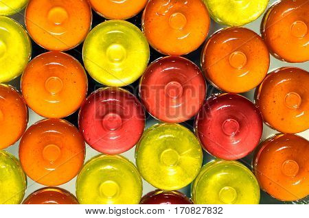 Colorful candy on background with yellow orange and pink sweetmeats candies. Dolce vita.