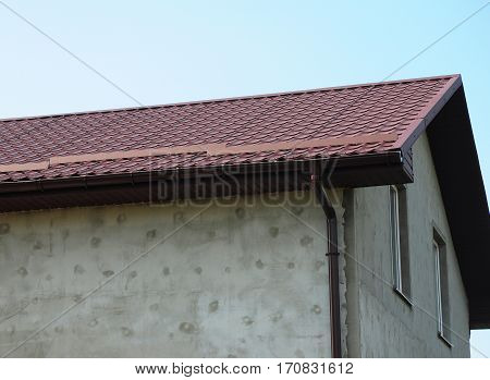 Roofing Construction with Stucco Wall and Rain Gutter System