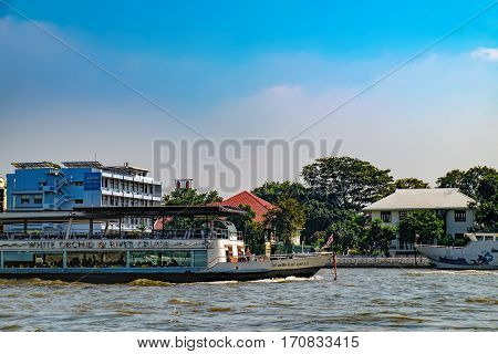 Bangkok, Thailand - December 22, 2015: Cruise Boat White Orchid is the popular boat travel on the Chao Phraya river and tourist attractions on both sides of the river. To stay in downtown Bangkok.