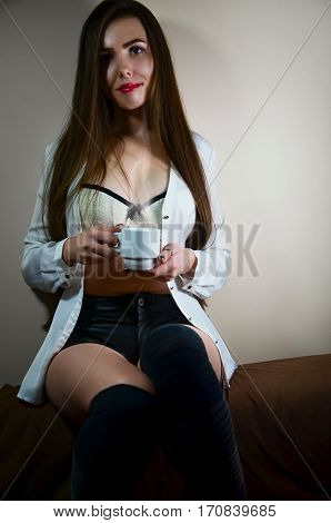 Young Girl With Coffee Cup