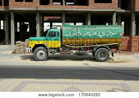 Hurghada, Egypt - November 5, 2006: Old tank truck driven by arabian driver moves on city street