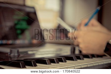 Musician in writing music song in his home studio