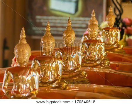 Figures of the sitting Buddha in the Wat Saket Temple. Buddhist Temple Wat Saket or Golden mount, Bangkok, Thailand. Selective focus