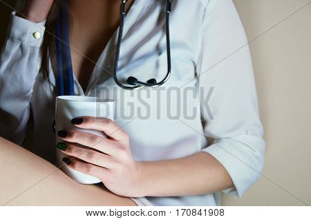 Young Nurse Girl Sitting With Coffee Cup