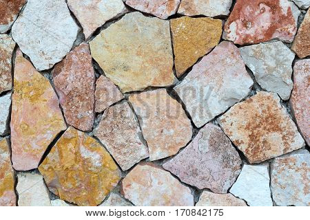 Background of stone wall texture photo brown