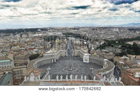 view of St. Peter's Square and the city of Rome from the dome of Saint Peter