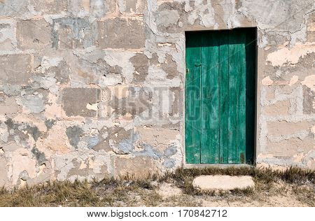 Old wooden door in a brick wall Mallorca Spain