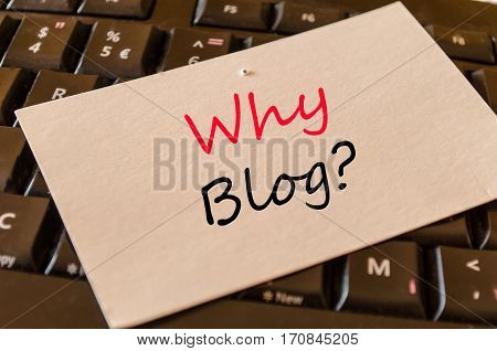 Why blog text concept on white memo and dark keyboard background