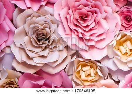 Colorful flowers paper background. Red pink purple brown yellow and peach handmade paper roses