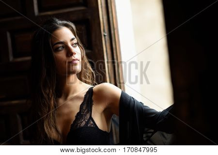 Sexy Young Woman In Lingerie Posing Near A Window