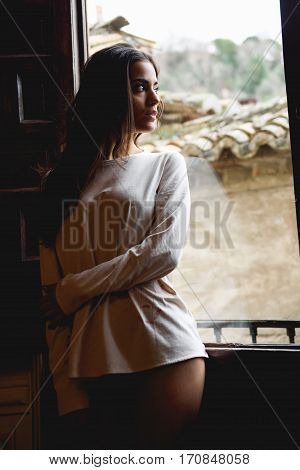 Woman In Pyjama And White Panties Posing Near A Window