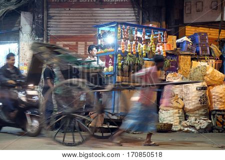 KOLKATA, INDIA - FEBRUARY 09: Traditional hand pulled indian rickshaw driver working on the street in Kolkata on February 09, 2016.