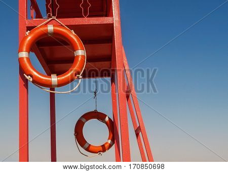 Red Rescue Tower With A Lifeline Against The Blue Sky