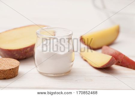 Sea Salt, Starch In The Jar, Cut The Potatoes Into Slices On A White Wooden Background