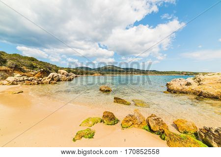 Rocks and sand in Alghero shoreline Sardinia