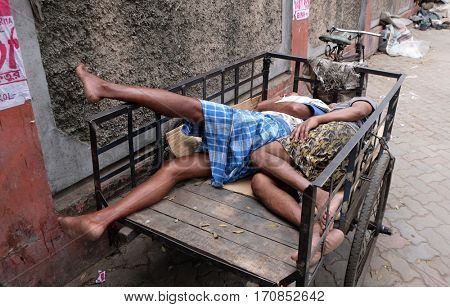KOLKATA, INDIA - FEBRUARY 11: Homeless people sleeping on the footpath of Kolkata, India on February 11, 2016.