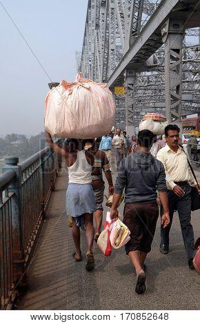 KOLKATA, INDIA - FEBRUARY 10: Indian worker on Howrah bridge where bear more than 100,000 vehicles and 150,000 pedestrians everyday, Kolkata, India on February 10, 2016.