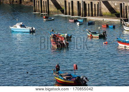 MADEIRA, PORTUGAL - SEPTEMBER 5, 2016: Fishing boats in Camara de Lobos Madeira Islands Portugal