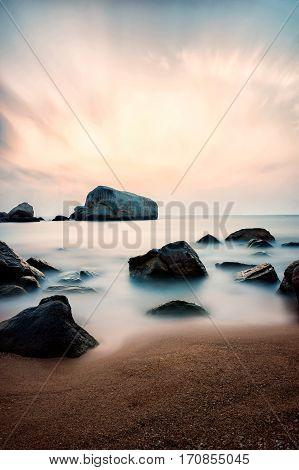 Beautiful coastal sunrise on the small paradise island Koh Tao in Thailand. Long exposure