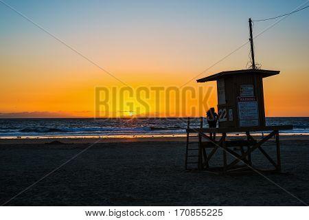 Girl on a lifeguard tower in Newport Beach California