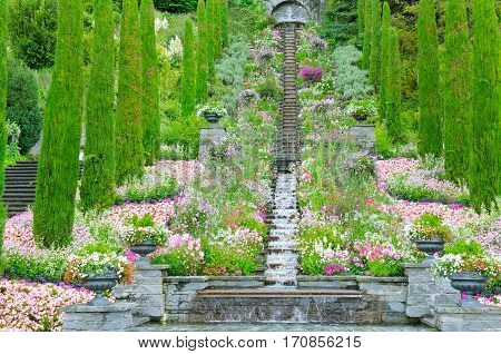 Flower garden and other plants a staircase and a waterfall on the island of Mainau (Lake Constance Germany)