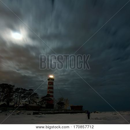 Shepelevsky lighthouse in a moonlit night, Leningrad region, Russia