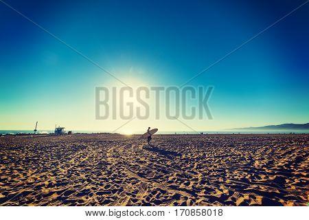 a surfer in Venice beach in California