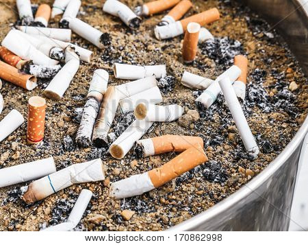 Many Smoked Cigarettes Butts in an ashtray