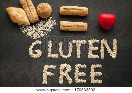 Gluten free bread for people that got special diet. Varios buns on black background, health care concept.