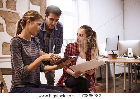 Concentrating Team Of Three Business People