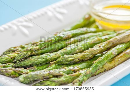 Delicious Roasted Asparagus on a White Plate