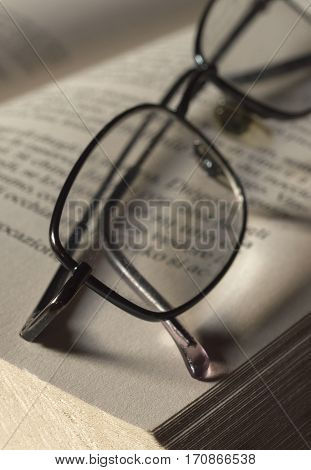 Pair of spectacles on the page of a book