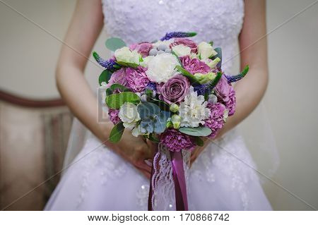 Bride In A White Dress Holding A Bouquet