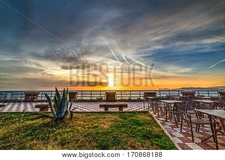 a colorful sunset in Alghero seafront Sardinia