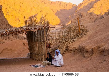 SHARM EL SHEIKH EGYPT - JULY 9 2009. Bedouin and Muslim woman selling goods to tourists in the desert.