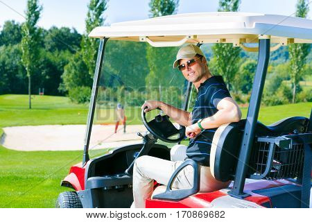 Adult man driving a golf cart, enjoying his favorite sport.