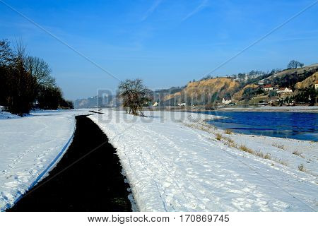 Bike path along the Elbe river in winter Meissen Saxony Germany